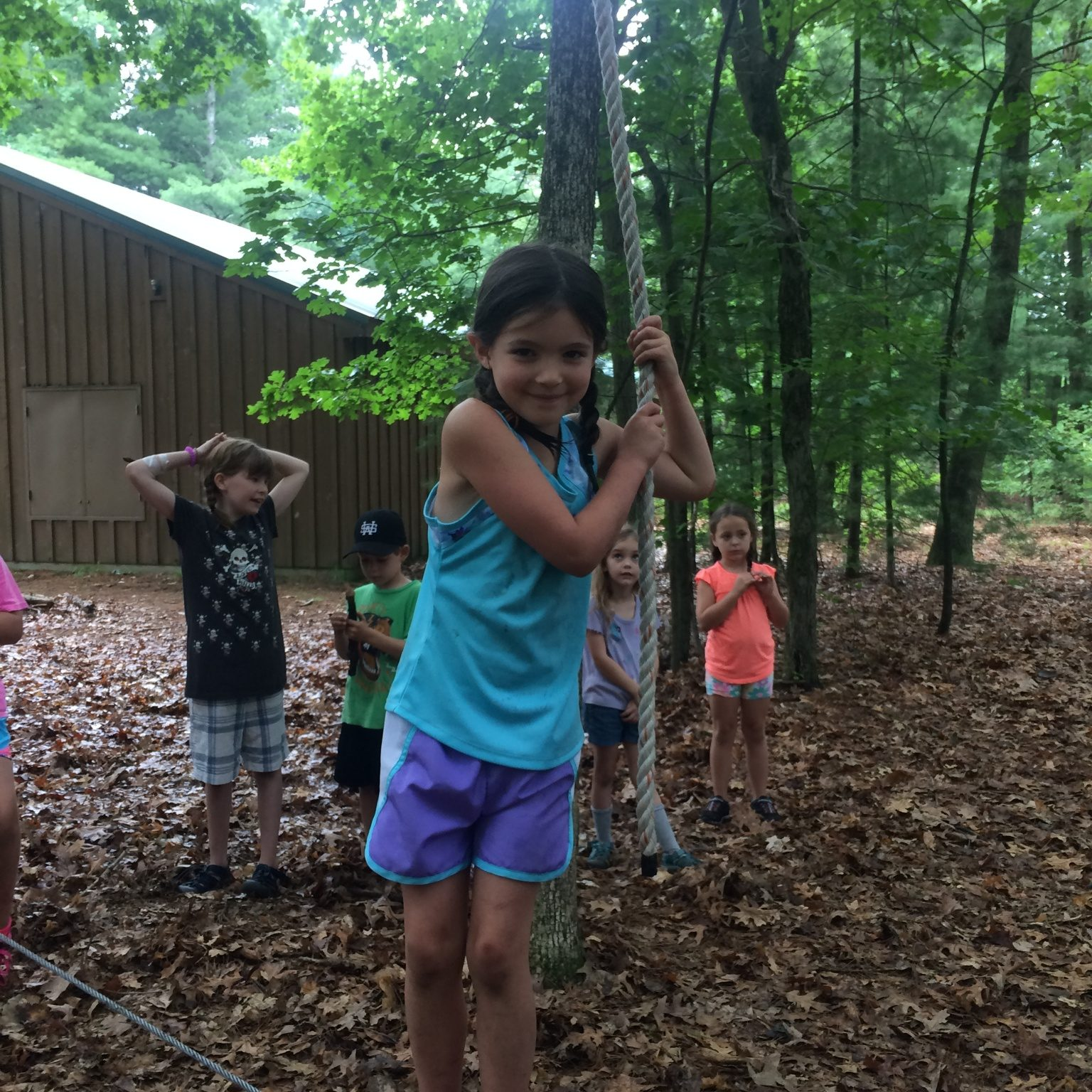 Youth experience low ropes challenges during an outing